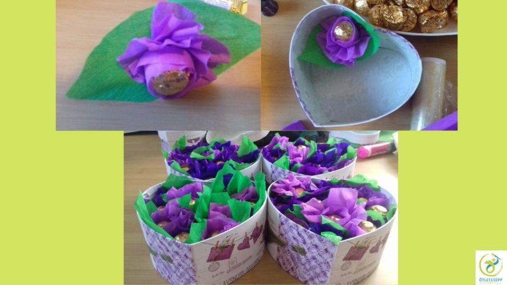 bonbon közepű virágfejek szív alakú dobozba rendezve